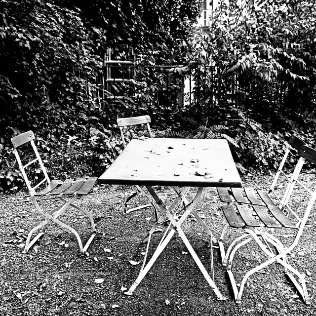 """""""Autumnal Garden, Chairs, Table and Fallen Leaves"""" stock image"""