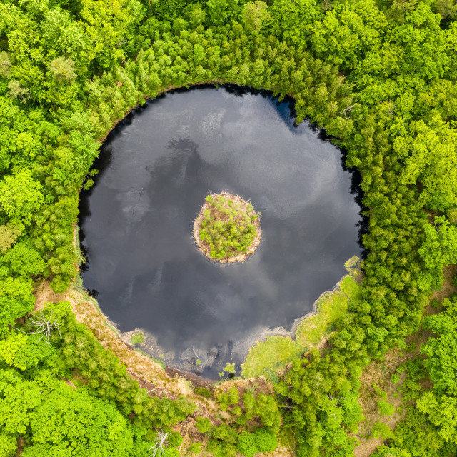 """""""Round lake with island in the middle among forest, aerial view"""" stock image"""