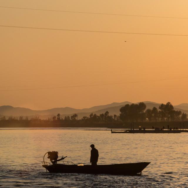 """""""Yalu River Trader"""" stock image"""