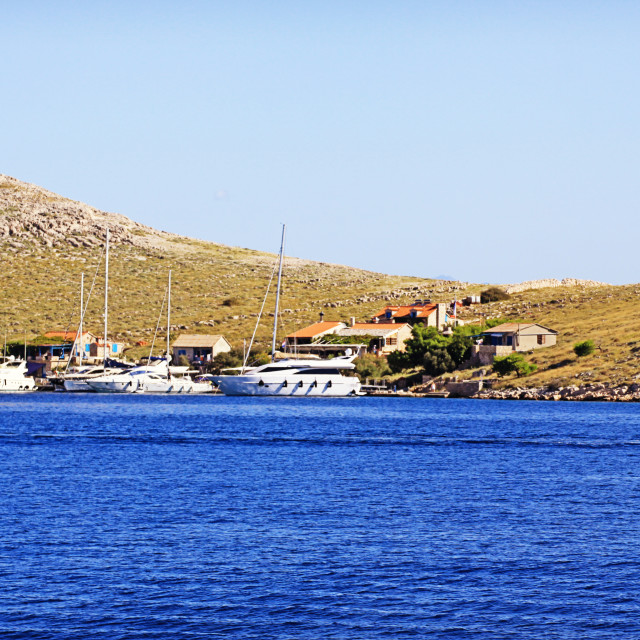 """""""Boats moored at a small cove"""" stock image"""