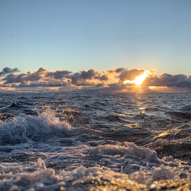 """""""Waves crash the sunrise, Black Rocks"""" stock image"""