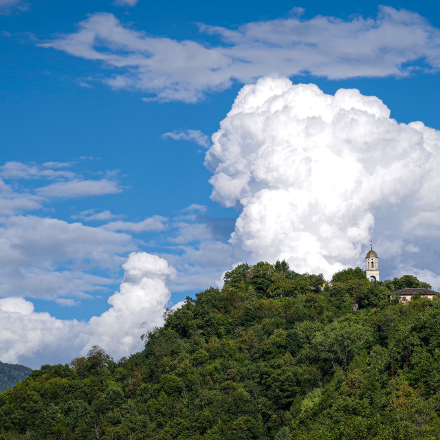 """""""Clouds above the church"""" stock image"""
