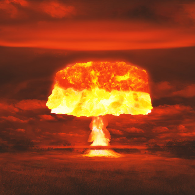 """""""Atomic bomb realistic explosion, red color with smoke, dim image"""" stock image"""