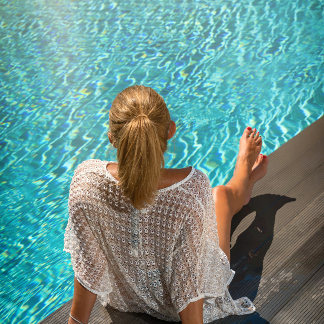 """""""Woman on the deck at the swimming pool"""" stock image"""