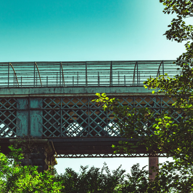 """Old Iron Bridge Surrounded By Trees With Clear Blue Skies - Bolton, UK"" stock image"