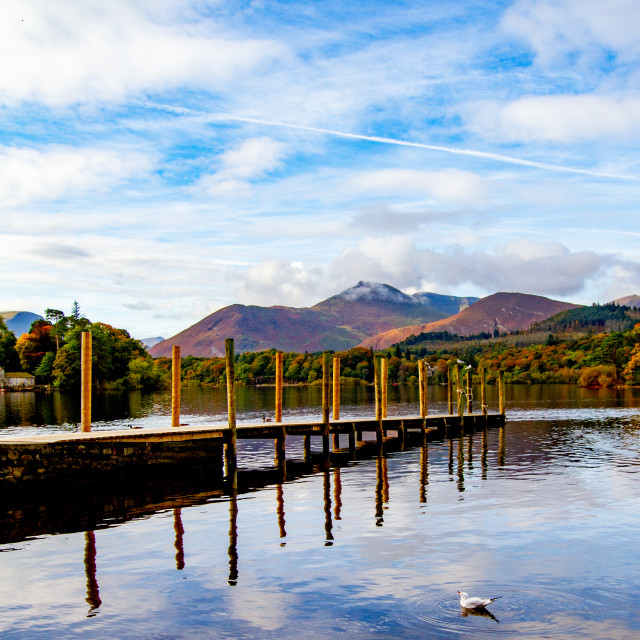 """""""'Derwentwater Wooden Jetty' and Reflections. Mountains in background. The Lake District, Cumbria, England."""" stock image"""
