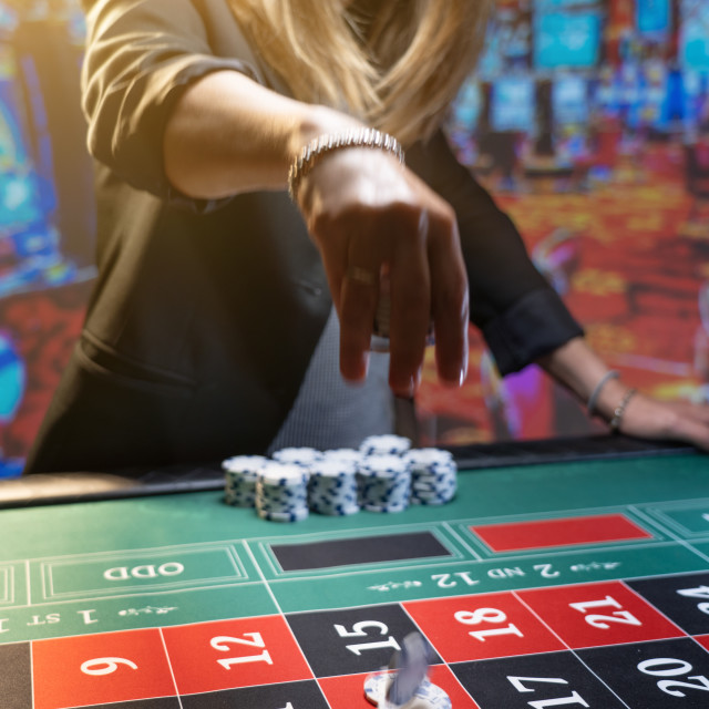 """""""Woman playing roulette at the casino"""" stock image"""