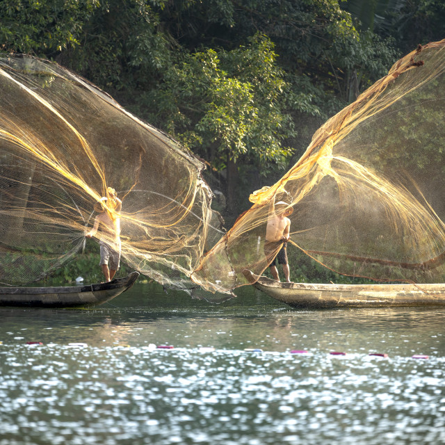 """""""Fishermen are throwing fishing nets into the river"""" stock image"""