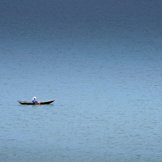 """""""Small boat of fishermen lonely on the green river in Hoi An"""" stock image"""