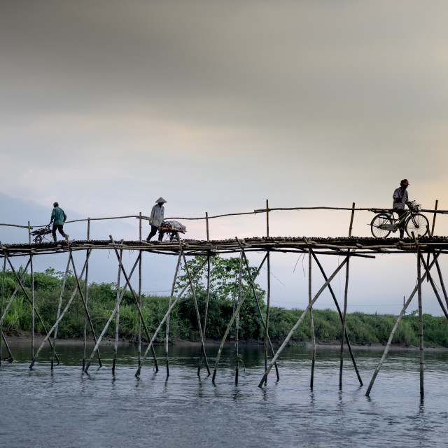 """""""Farmers go to work on a bridge made of bamboo"""" stock image"""