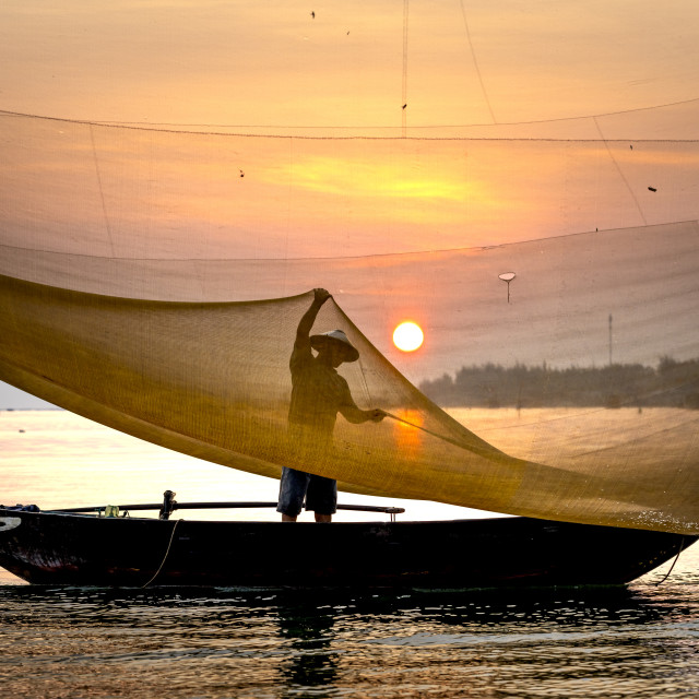 """""""Fishermen are working on the Thu Bon River in Hoi An, Quang Nam province, VietNam"""" stock image"""