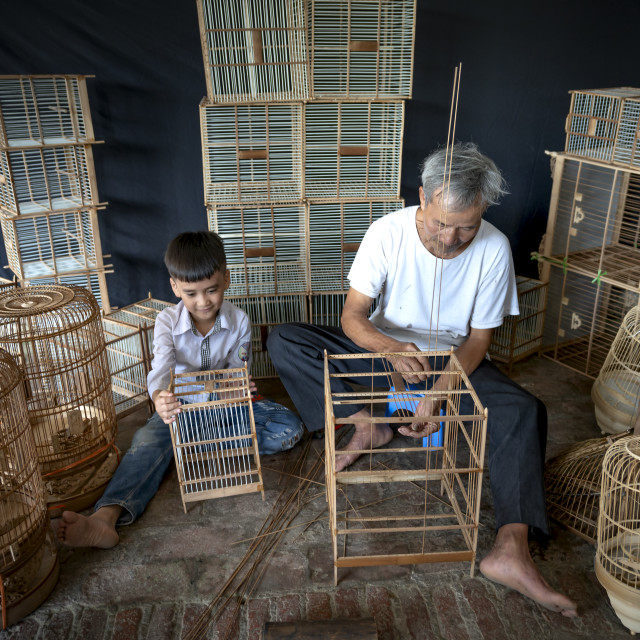 """""""Picture of an artisan is making bird cages"""" stock image"""
