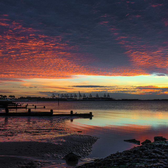 """Red Sky Delight Over Dovercourt Beach"" stock image"