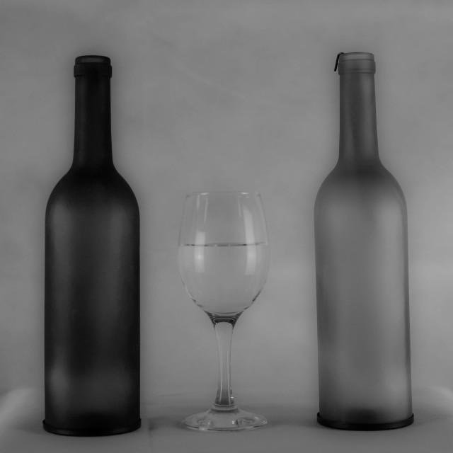 """Bottles & a Glass"" stock image"