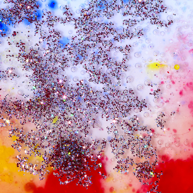 """""""Abstract pattern of oil acrylic paint and glitter floating on the surface of water"""" stock image"""