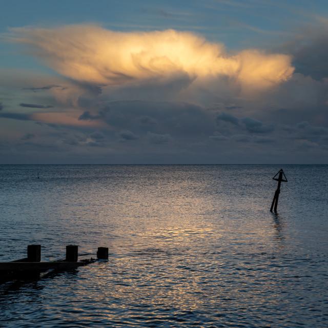 """Evening Light on Storm Cloud, Felixstowe, Suffolk"" stock image"