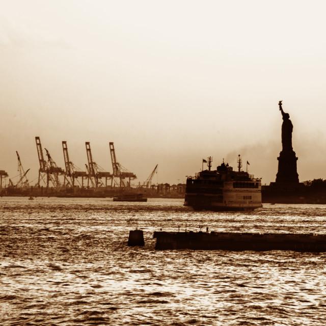 """Golden hour light over New York Harbor islands"" stock image"