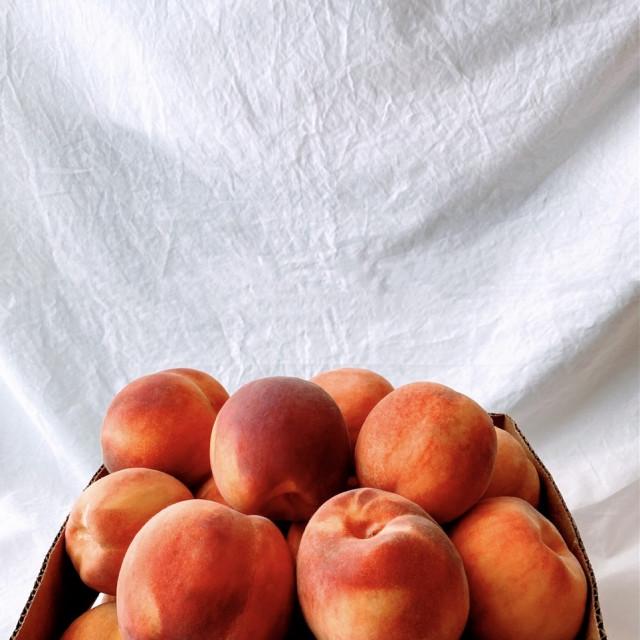 """Box of ripe peaches"" stock image"