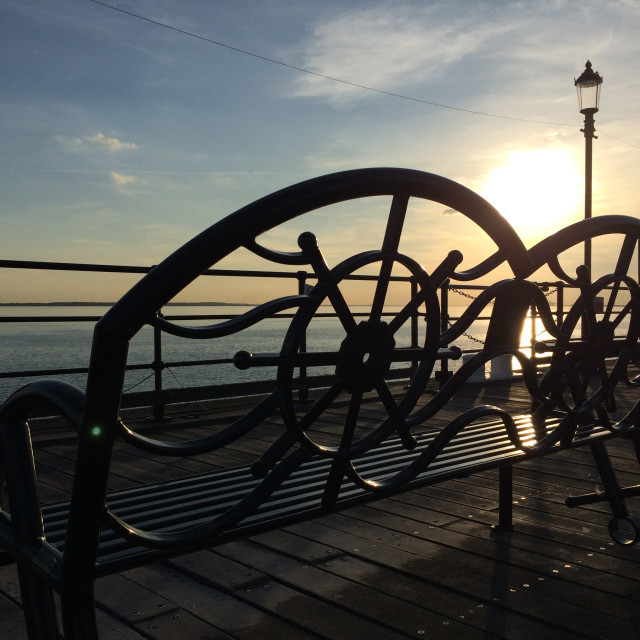 """Sunset Bench on Southend Pier"" stock image"