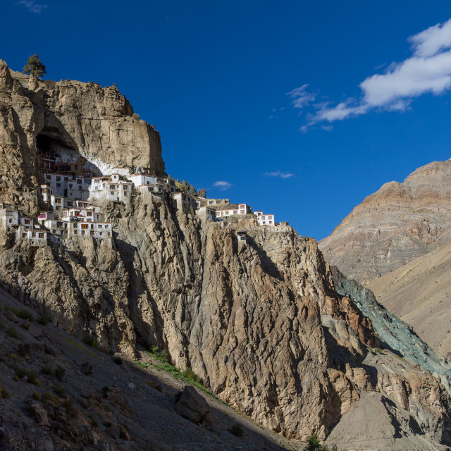 """Phugtal Gompa clinging to the cliff high above the river"" stock image"