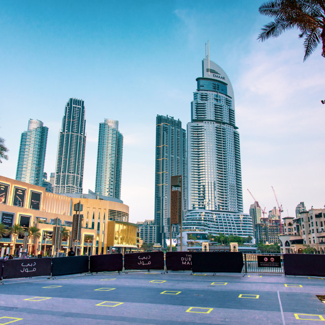"""""""Dubai mall with social distancing squares for people to stand into and keep distance as new normal for mall reopening after coronavirus Covid 19 pandemic"""" stock image"""