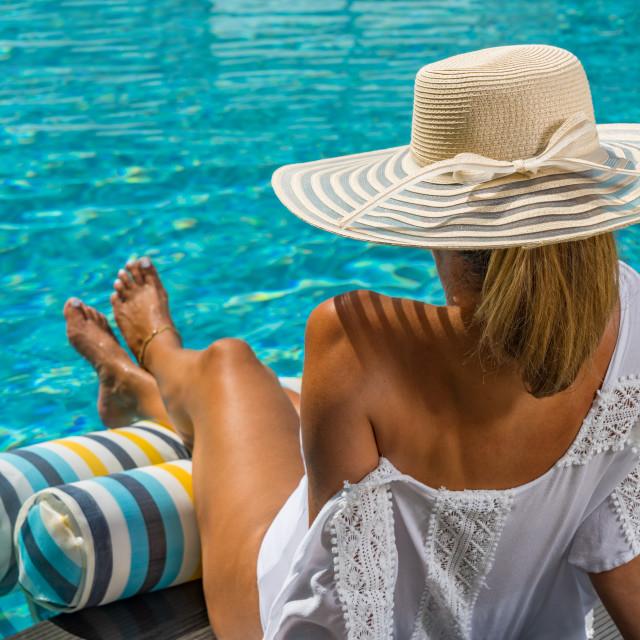 """woman in luxury spa resort near the swimming pool."" stock image"