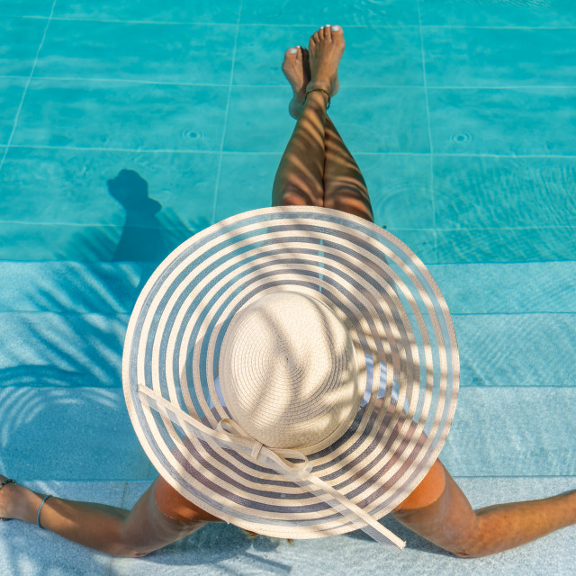 """""""woman in luxury five stars spa resort at the pool."""" stock image"""