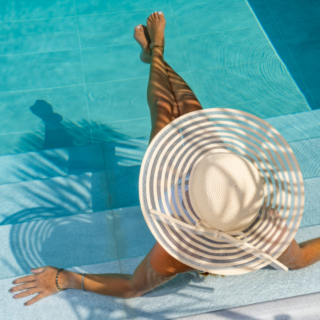 """""""woman at spa resort by the swimming pool."""" stock image"""