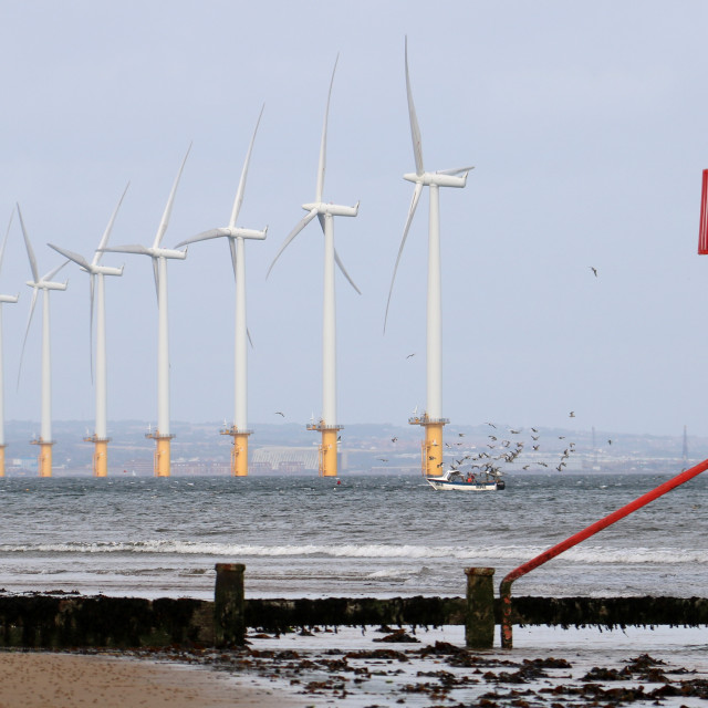 """Teesside windfarm from Redcar beach"" stock image"
