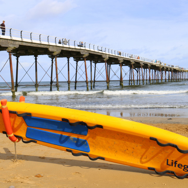"""Saltburn Pier and beach watched over by the Lifeguards."" stock image"