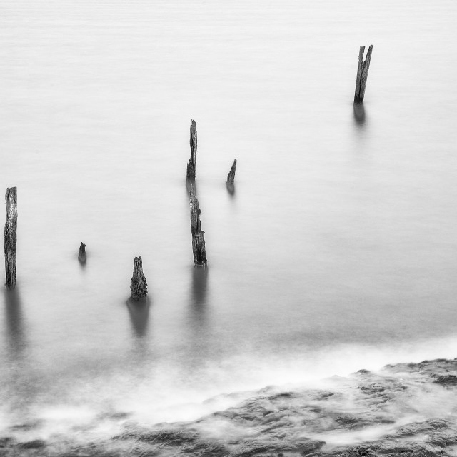 """""""Old Posts at Lindisfarne."""" stock image"""