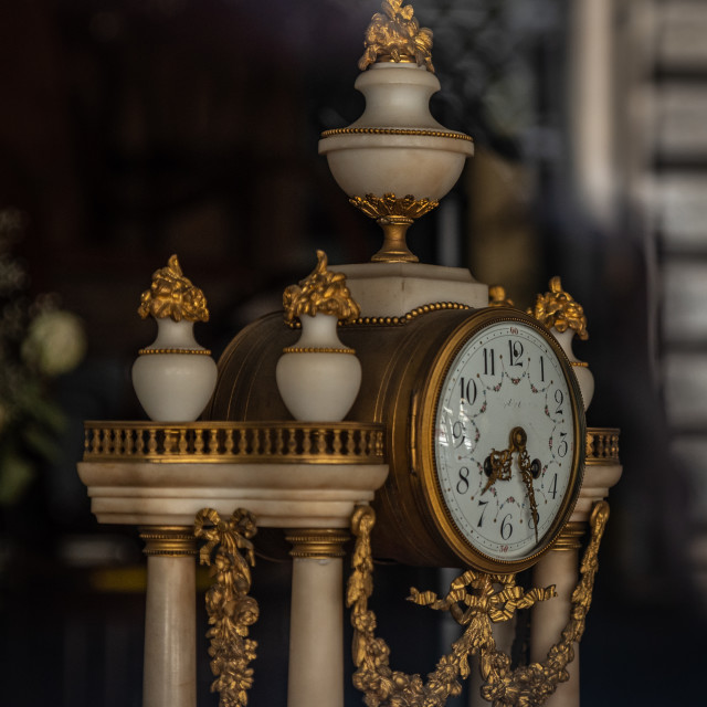 """Antique table clock with marble and gold details"" stock image"