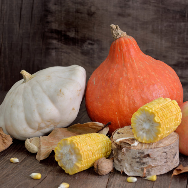 """various and colorful autumnal vegetables and fruits on wooden background"" stock image"