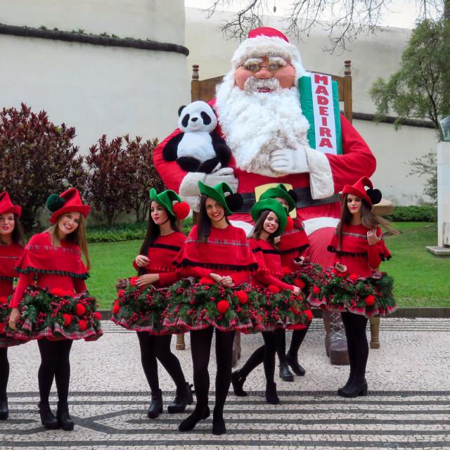 """Christmas girls posing with Santa Claus"" stock image"