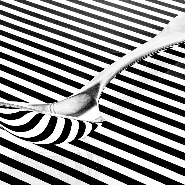 """""""Reflections in a silver spoon"""" stock image"""