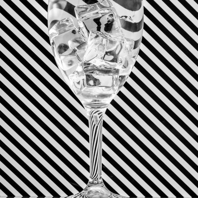 """""""Ice bending light in a wineglass"""" stock image"""
