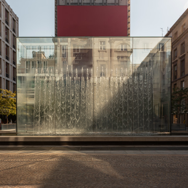 """Modern fountain with water splashes on a huge glass window cut b"" stock image"