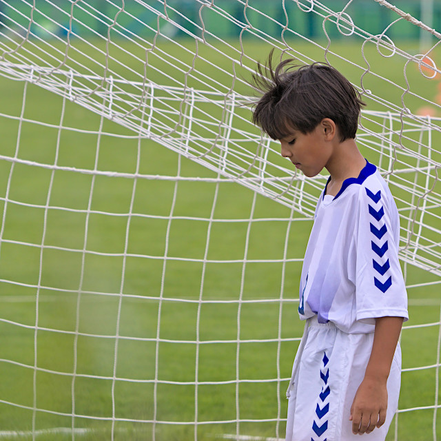 """A sad young soccer player"" stock image"