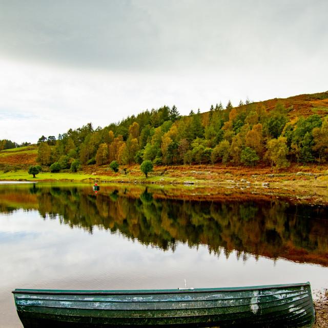 """Small Boat at Lakeside, Cumbria,"" stock image"