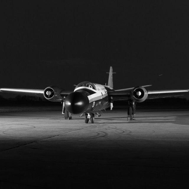 """""""The former Royal Aircraft Establishment Canberra sits on the floodlit pan after dark."""" stock image"""