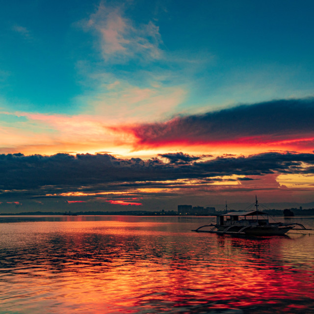 """Clouds On Fire As The Sun Sets Over Pacific Resort - Cebu, Philippines, Asia"" stock image"
