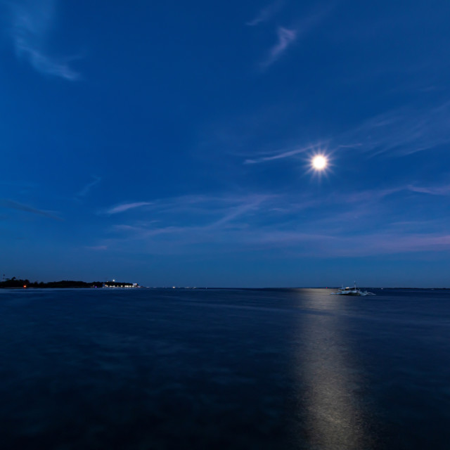 """Full Moon Rising And Leaving Reflections Over The Ocean Water at Pacific Resort - Philippines, Asia"" stock image"
