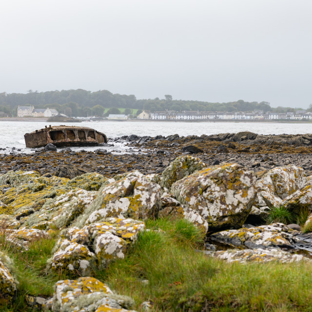 """Coastline of Garlieston Bay with Garlieston town in the background, Dumfries & Galloway, Scotland"" stock image"