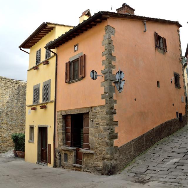 """Mediaeval townhouse in Cortona, Tuscany"" stock image"
