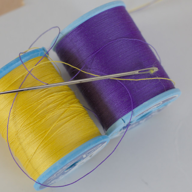 """spools of yellow and purple thread"" stock image"