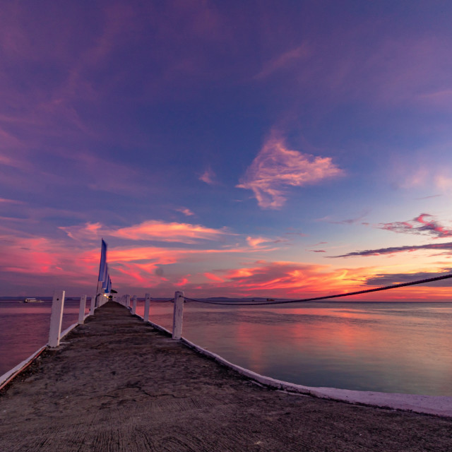 """The Summer Sun Sets Over The Pier At Pacific Resort - Cebu, Philippines, Asia"" stock image"