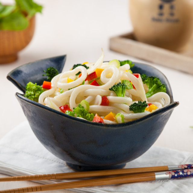 """Udon, Japanese noodles with vegetables in a handmade ceramic bow"" stock image"