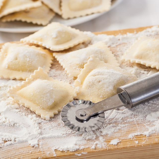 """Making homemade Italian pasta ravioli with a cutting tool"" stock image"