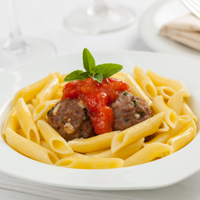 """A beautiful plate of italian penne pasta with meat balls and tom"" stock image"