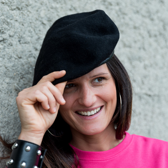 """""""Close up portrait of smiling girl wearing a black beret and a fu"""" stock image"""